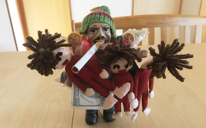 エケコ人形に子供を背をわせて妊娠する